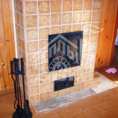 Печь-камин с облицовкой изразцами серии Русь